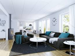 Black Leather Sofa With Cushions Black Fabric Sofa With Blue Cushions And Round White Table On