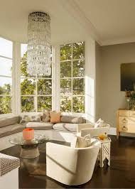 bay window decorated with sheer curtains and string lights