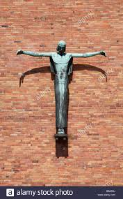 sculpture of jesus christ on the cross at the jesus christ church