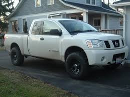 nissan titan oem wheels post pics of your black wheels on white titan nissan titan forum