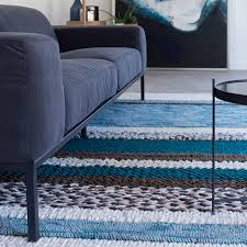 norway hand knotted 100 wool rug in blue by cuckooland