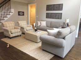 grey couches patterned chairs jute rug cream leather ottoman