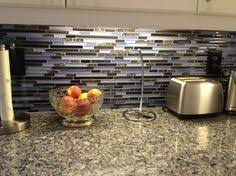 grey cabinets with blue pearl granite counter maybe with a