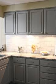 painted gray kitchen cabinets with white subway tile backsplash