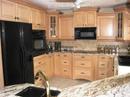 warm modern kitchen modern kitchen with black appliances brown glass mosaic backsplash