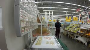ufa russia 05 06 2016 ufa oct 13 the girl chooses wine in a supermarket auchan on