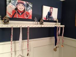 medal and trophy display for the boys room finally after a year