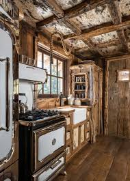kitchen lit fire in fireplace country kitchen with rustic wooden