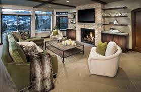 view in gallery cozy family room with floating shelves and a tv above the fireplace