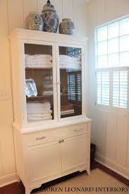 repurpose china cabinet in bedroom repurposed china cabinet for bathroom storage one room challenge