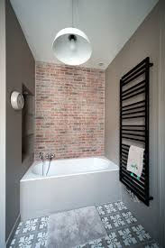 brick wall tile bathroom rustic with burled wood built in shelves