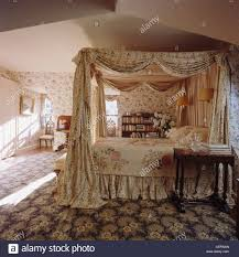 patterned drapes on four poster bed with antique patchwork quilt