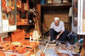 a moroccan woodworking artisan shapes his trade pyxera global