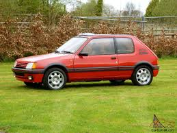classic peugeot 205 1 9 gti in cherry red the best hatch pocket rocket now