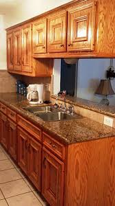 Kitchen Cabinet With Countertop Honey Oak Kitchen Cabinets With Black Countertops And Green Walls