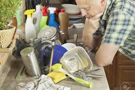 Man Washing Dirty Dishes In The Kitchen Sink Domestic Cleaning - Dirty kitchen sink