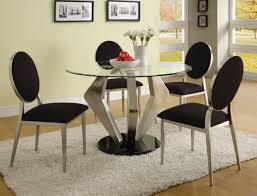 dining room a modern round glass top dining room table with