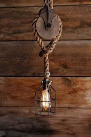 pulley pendant light fixtures the wood wheel pulley pendant light rustic industrial cage