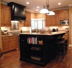 maple cabinets with black island alder cabinets beautiful black kitchen island with bar seating