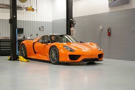 orange porsche porsche 911 gt1 stars at porsche of colorado springs grand opening