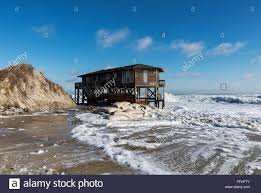 Small Beach House On Stilts Beach House On Stilts Surrounded By High Tide Surf Nags Head