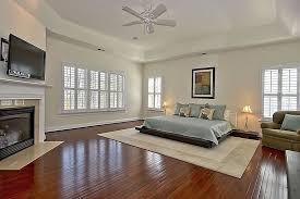 Bedroom With Area Rug Contemporary Master Bedroom With Metal Fireplace U0026 Ceiling Fan In