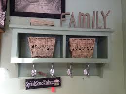 brown wall shelf with hooks