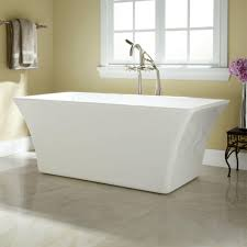wooden laminate flooring idea with white stand alone bathtub using