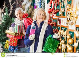 senior woman shopping christmas ornaments at store royalty free