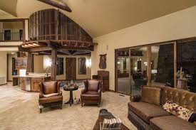water tower inspired home living room looking at foyer and upper