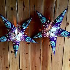 paper star lights purple and blue modern day hippie
