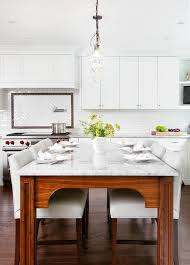 kitchen island as dining table with white leather counter stools