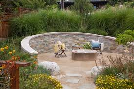 stone wall landscaping ideas patio beach style with yellow flowers