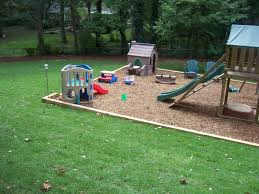 swing set with railroad ties and mulch outdoors pinterest