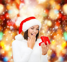 surprised woman in santa helper hat with gift box stock photo