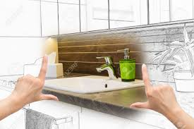 female hands framing custom bathroom design combination drawing