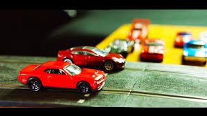 koenigsegg scalextric tesla p90d vs dodge hellcat toys gas 2