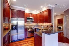 burgundy kitchen with tile back splash trim steel appliances