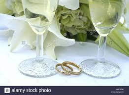 glass wedding rings symbol wedding wedding rings two glasses of sparkling wine and