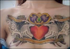 nice one red heart and hands with brilliant crown tattoo for