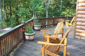 attractive log cabin porch rails with wooden bucket planter and