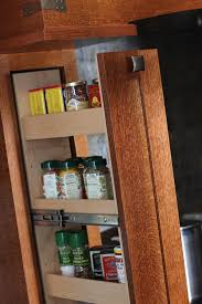 crafty storage a pull out spice rack next to the cooking surface