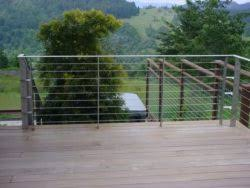stainless steel cable railing on a deck near the coast fabworx