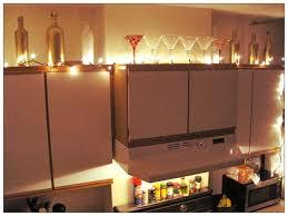 lighting and ivy above kitchen cabinets kitchen decor bottles