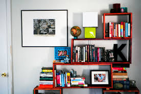 Pinterest Bookshelf by Red Bookshelves On White Wall Connected By Black Picture Frames Of