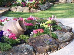 adorable rock garden design with clay jar and colorful bulbs and