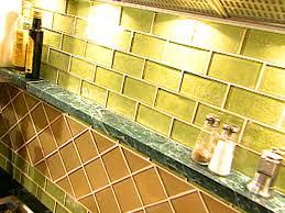 how to install a glass tile backsplash in the kitchen glass tile backsplash video diy