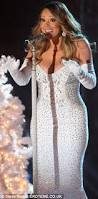 mariah carey slips into plunging red and white dresses to sing at