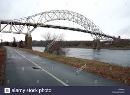 the sagamore bridge and bike path along the cape cod canal stock