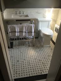 c10 sm1 bathroom with statuario basket weave flooring rai designs